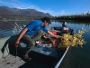 charile-swaney-putting-moose-meat-on-boat-on-east-fork-of-chandalar-river-near-arctic-village-2002